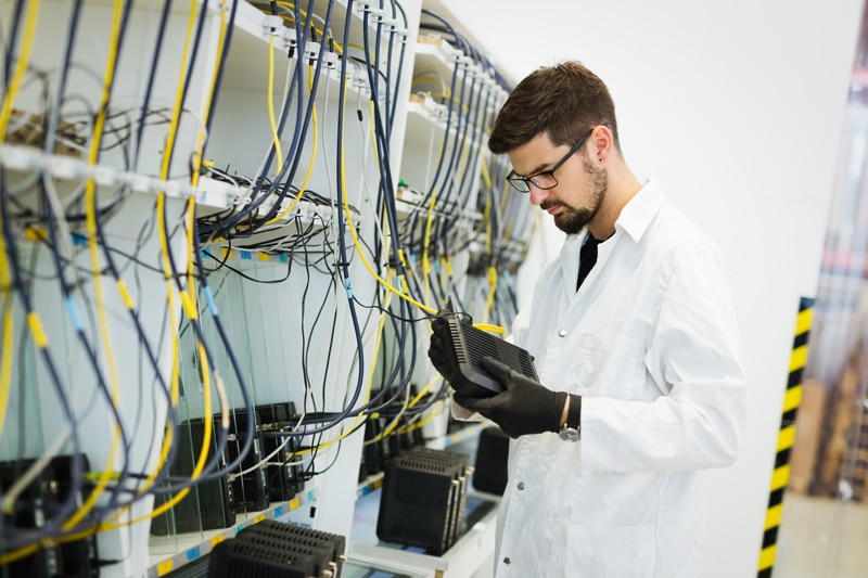 Information technology professional working in a network lab