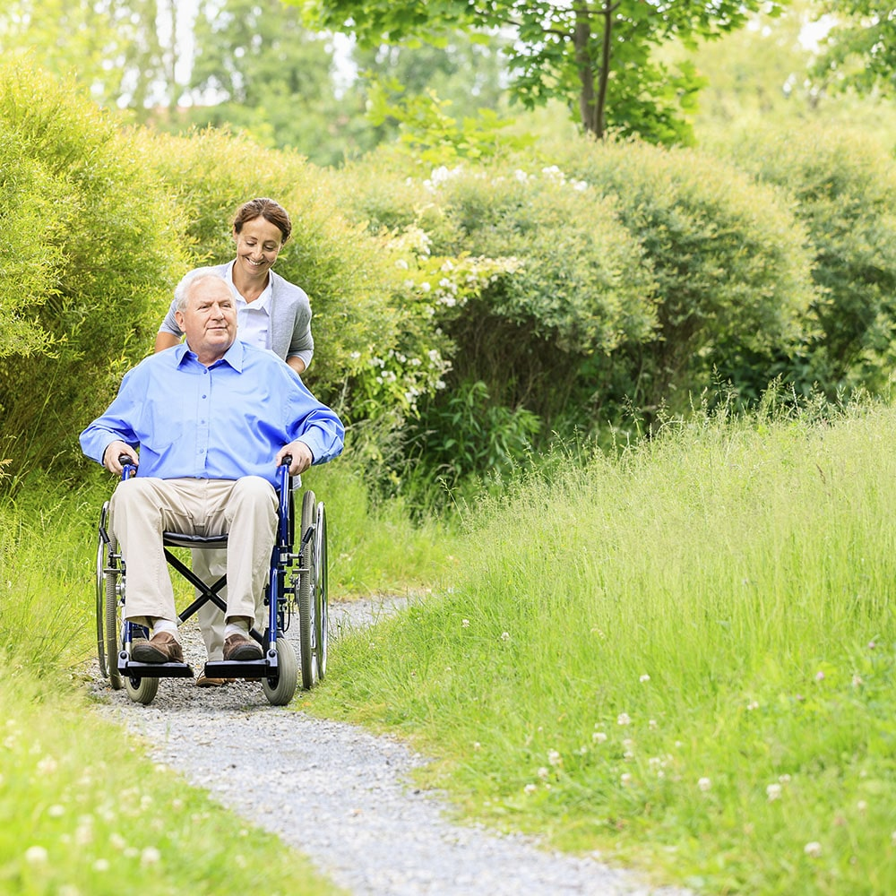 Personal Support Worker helping male patient on wheelchair