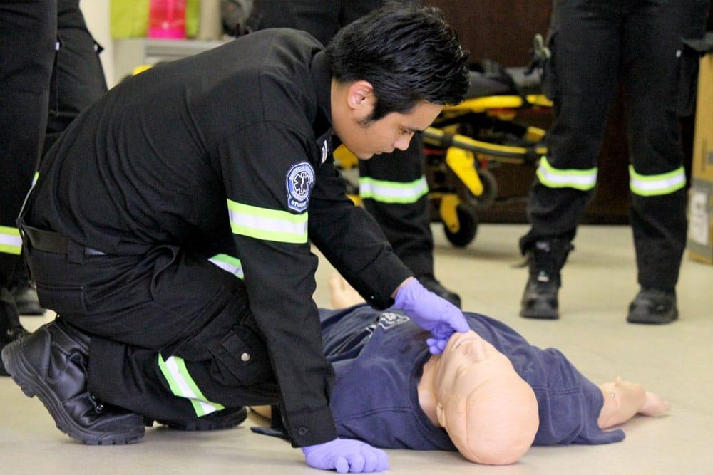 Paramedic student performing lab scenario