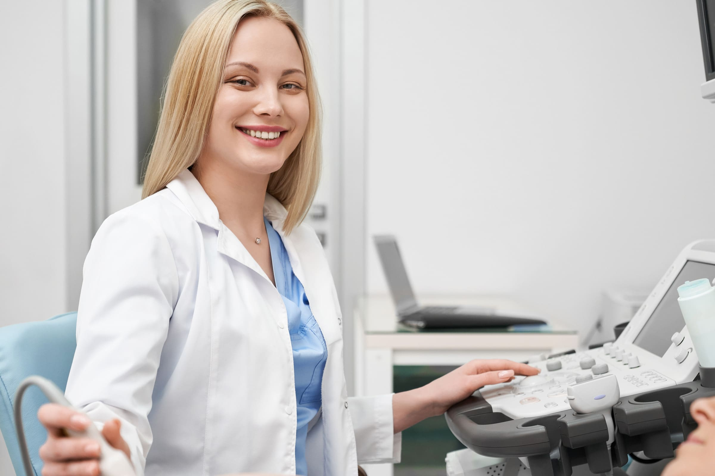Female performing cardiovascular sonography